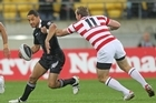 Benji Marshall of the Kiwis is tackled by Gareth Ellis of England. Photo / Getty Images