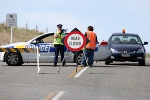 Police cordon off State Highway 93 after the fatal accident between Mataura and Clinton. Photo / NZPA.