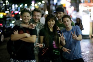 Nick Dwyer (far right) and his TV show  Making Tracks  hitting the streets of Tokyo. Photo / Supplied