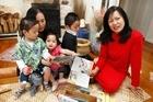 Manasseh Faaui (L), 3, Cathy Faaui, Hannah Faaui, 14 months, Joshua Faaui, 5 and Judy Taligalu Mcfall with one of the Samoan books.  Photo / Steven McNicholl