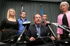 An upset John Banks and family at press conference following his loss in the Supercity Election. Photo / Herald on Sunday