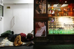 A person sleeps in a doorway on Auckland's Queen Street. Photo / Greg Bowker.