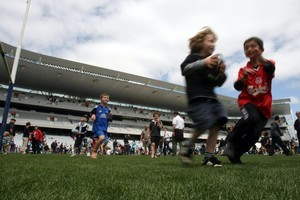 Children tried out Eden Park's new turf at its recent open day. Photo / Dean Purcell