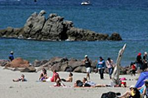 Crowds of people enjoyed the sunny weather at Mt Maunganui beach during last year's Labour weekend. Photo / Bay of Plenty Times