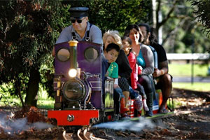 People enjoy a ride on one of the miniature trains run by the Manukau Live Steamers at Mangere Centre Park. Photo / Steven McNicholl