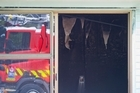 The scene of a fire at a suspected P lab on Herdman Street in the Auckland suburb of Waterview. Photo / NZPA