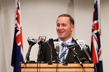 Prime Minister John Key announces that the Hobbit movies will be filmed in New Zealand. Photo / Getty Images