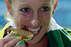 Australia's Anastasia Rodionova displays her medal. Photo / AP.