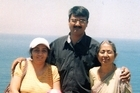 Hiren Mohini, pictured here with his family, was murdered in the Auckland suburb of Mt Eden in January. Photo / Supplied