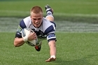 Gareth Anscombe of Auckland scores a try. Photo / Getty Images