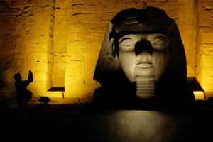 A tourist takes photos at the Temple of Luxor. Photo / Alan Gibson