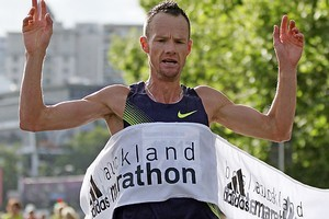 Dale Warrander crosses the finish line of the 2010 Auckland Marathon. Photo / Getty Images