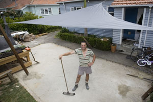 Justin Newcombe shows off his completed shade sail. Photo / Paul Estcourt