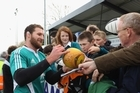 No 8 Kieran Read meets fans after an All Blacks training session in Dublin yesterday. Photo / Getty Images