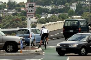 A cyclist negotiates traffic at the intersection of Tamaki Drive and Ngapipi Road. Photo / Dean Purcell