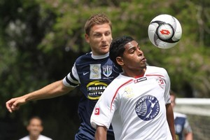 Waitakere United scorer Roy Krishna (No 12) and Auckland City's Martin Bullock contest the ball in their O-League soccer match played at Fred Taylor Park. Photo / Paul Estcourt
