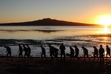 Boot campers make their way across Cheltenham Beach. Photo / Sarah Ivey