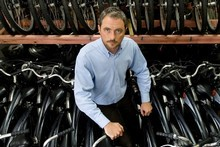 NextBike director Julian Hulls with the hire bikes they have had to pull from Auckland Streets. Photo / Richard Robinson.