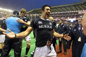 Flanker Kelly Brown enjoys Scotland's surprise win in the rain at Murrayfield. Photo / Getty Images