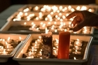 Candles burn after a special service at the Holy Trinity Anglican Church. Photo / Mark Mitchell