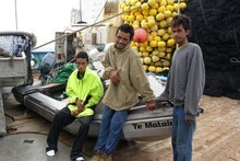 Filo Filo, 15, Samuel Pelesa, 15, and Edward Nasau, 14, on board the San Nikunau with the craft on which they spent 50 days lost at sea. Photo / Supplied