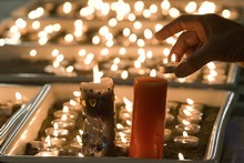 Candles burning at the Holy Trinity Anglican Church in Greymouth. Photo / Mark Mitchell