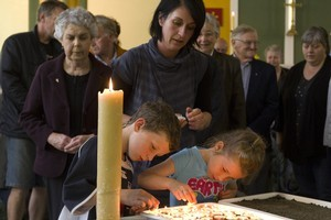 Church goers light candles during a special service after the first Pike River blast. Photo / Mark Mitchell
