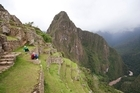 Tourists enjoy the view from Machu Picchu. Yale University is in negotiations to return to Peru artefacts taken from the site. Photo / Thinkstock