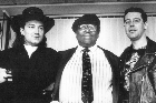 U2, with BB King (centre) at their Auckland Airport press conference in 1989. Photo / Yanse Martin