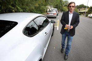AC/DC drummer Phil Rudd leaves Tauranga District Court after pleading guilty to cannibis charges. Photo / Bay of Plenty Times