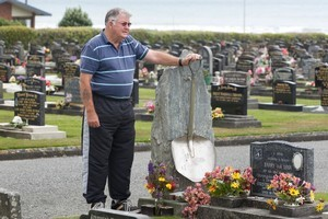 Jim O'Donnell at the graves of his mates _ many of whom he dragged from Strongman after the explosion in 1967. Photo / Mark Mitchell