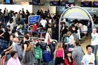 The scene at Auckland International Airport yesterday as delayed passengers queue to check in. Photo / Natalie Slade