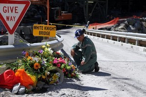 A miner pauses for a moment's silence at the White Knight Bridge near the entrance to the Pike River mine. Photo / NZPA