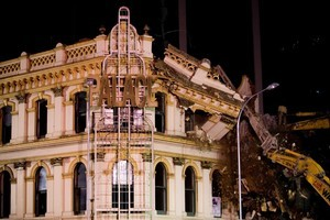 Demolition crews move in to pull down the Palace Hotel on Victoria Street, opposite Sky City, after large cracks appeared on the building. Photo / Dean Purcell