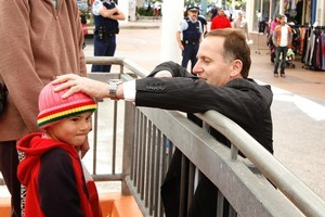 Prime Minister John Key meets Koria Taana, 4, while campaigning in the Mana, where there was a big swing away from Labour. Photo / Mark Mitchell
