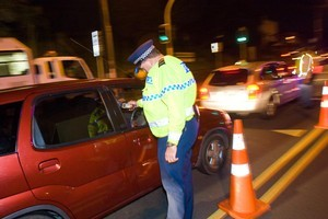 The National-led Government will keep the blood alcohol limit at 80mg - for now. Photo / Herald on Sunday
