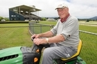 Caretaker Con Richards mowing lawns at the Omoto Race Course near Greymouth in preparation for Thursday's remembrance service. Photo / Mark Mitchell