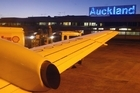 Flights were grounded at Auckland International Airport last night. Photo / APN