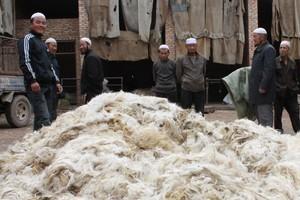 Hui men selling wool at a village market. Photo / Jim Eagles
