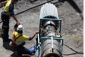 Mines rescue crew  working on the gag machine. Photo / Pool, The Press