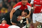 Mils Muliaina is tackled during the All Blacks' win over Wales. Photo / Getty Images