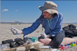 Dr Felisa Wolfe-Simon processing mud from a dried lake bed during her study about growing microbes on arsenic. Photo / NASA