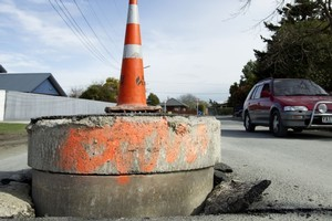 A sewer pipe that was pushed up through the street by the quake. Photo / Simon Baker