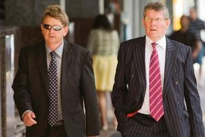 Stephen Gerard Versalko (L) arriving at Auckland District Court with his lawyer Stuart Grieve, QC, today. Photo / NZPA