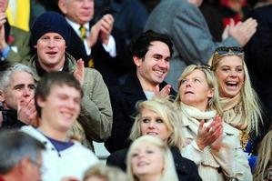 Prince Harry, left, and his girlfriend Chelsy Davy, right, look on during the Investec Challenge Series match between England and Australia at Twickenham on November 7, 2009 in London, England. Photo / Getty Images