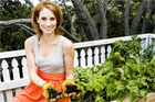 TV3 presenter Samantha Hayes sits by her garden balcony vegetable garden. Photo / Babiche Martens