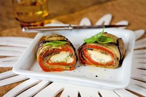 Eggplant roulade, grilled peppers, zucchini, fresh mozzarella and basil. Photo / Babiche Martens