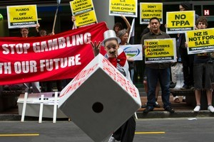 Simon Oosterman rolls the dice in protest against the Trans-Pacific Partnership Agreement. Photo / NZPA