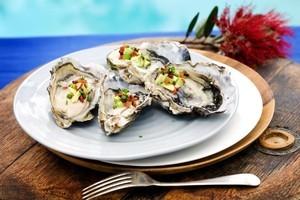 Oysters, crispy bacon, avocado and champagne vinegar. Photo / Babiche Martens