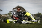 Niki Urwin posing proudly in his racing go-kart. Photo / Bay of Plenty Times